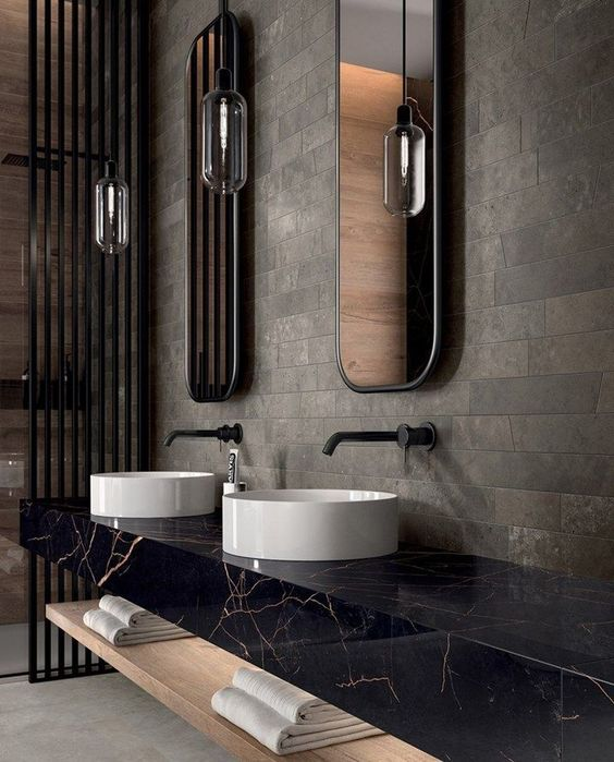 black stone bathroom vanity with double white vessel sinks and matte black sink hardware