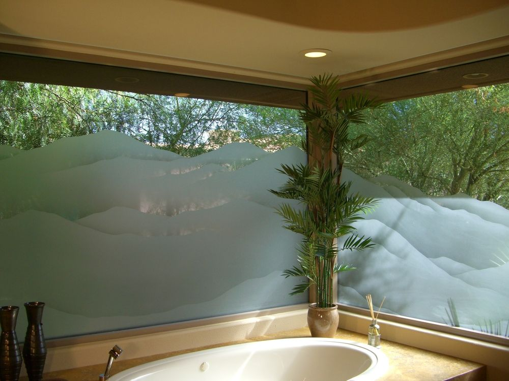 two windows with custom mountain frosted glass and natural light