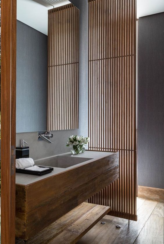 natural wood and concrete single sink floating vanity in bathroom wood slats