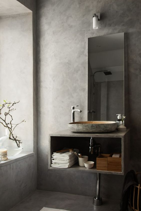 gray bathroom with concrete accents on the single sink bathroom vanity