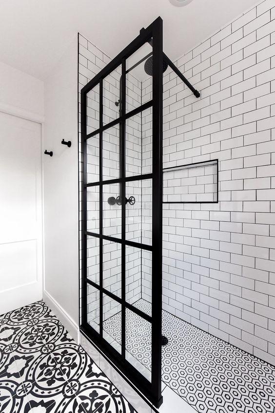 bathroom design trends of 2019 walk in shower with black grout white tile geometric tile shower floor