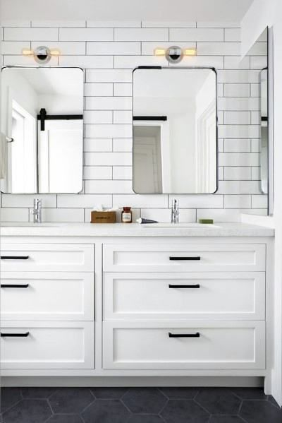 all white bathroom with subway tile backsplash and matte black accent features