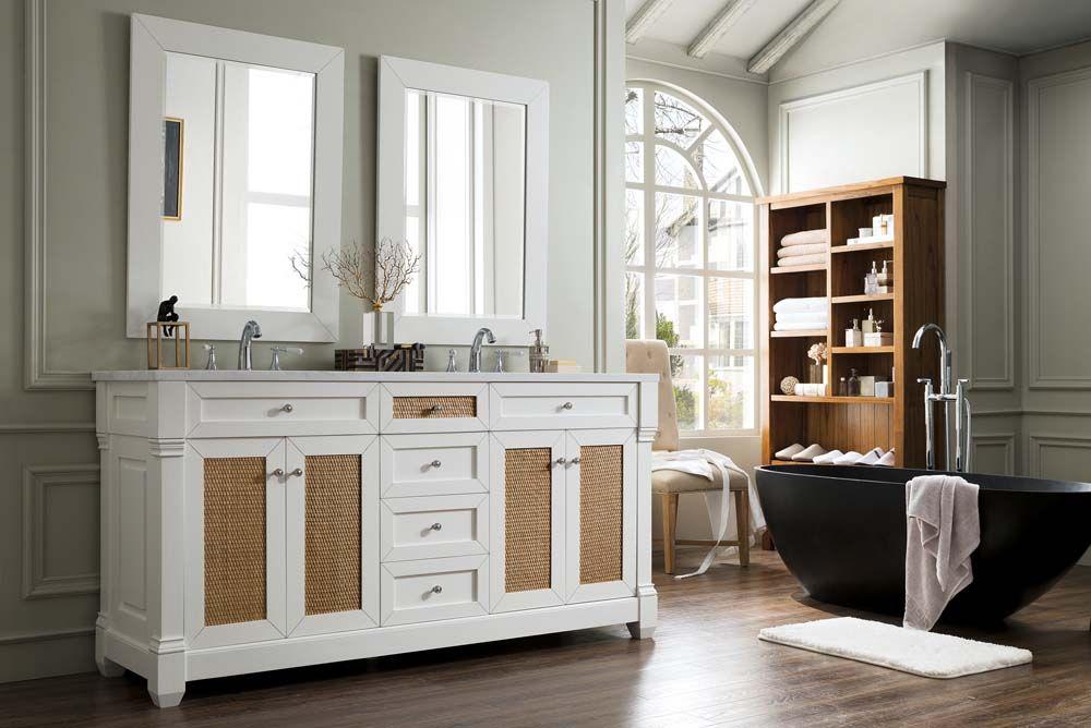White bathroom vanities with natural elements like raffia doors look great