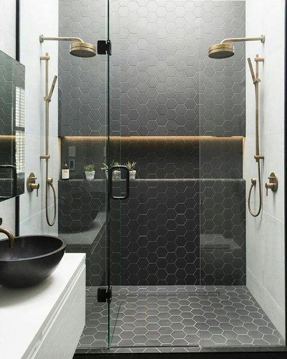bathroom design trends of 2019 black geometric tile with gold shower fixtures