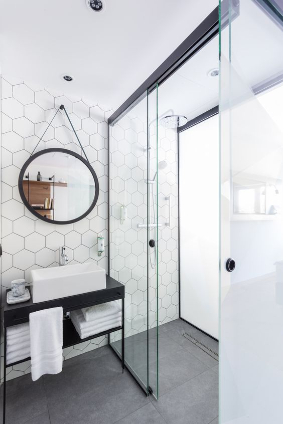simple black single vessel sink bathroom vanity with geometric tile backsplash