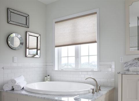 bathroom shades half open natural light near bathtub
