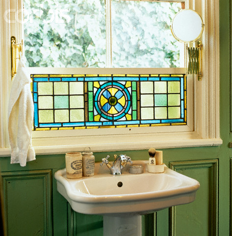 half window stained glass treatment natural light traditional vanity