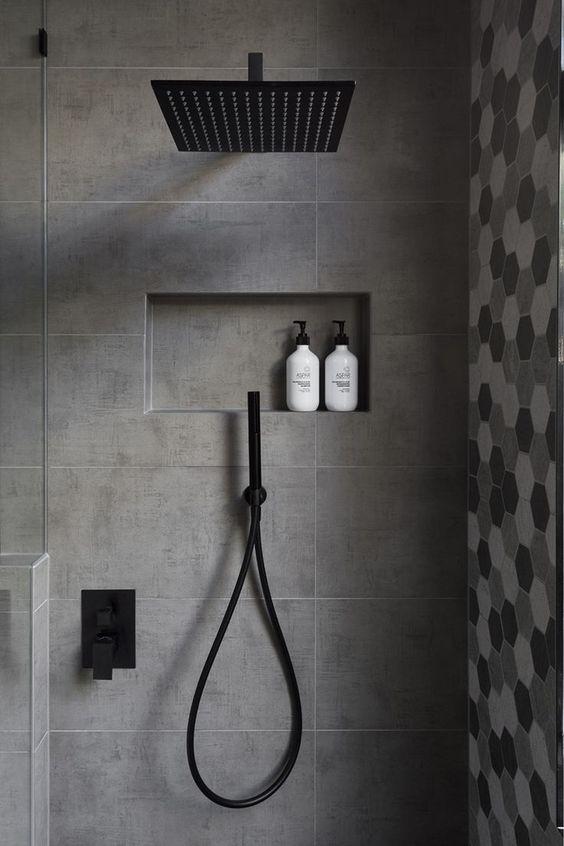 walk in showers matte black finish shower head matte black fixtures gray tile geometric patterns