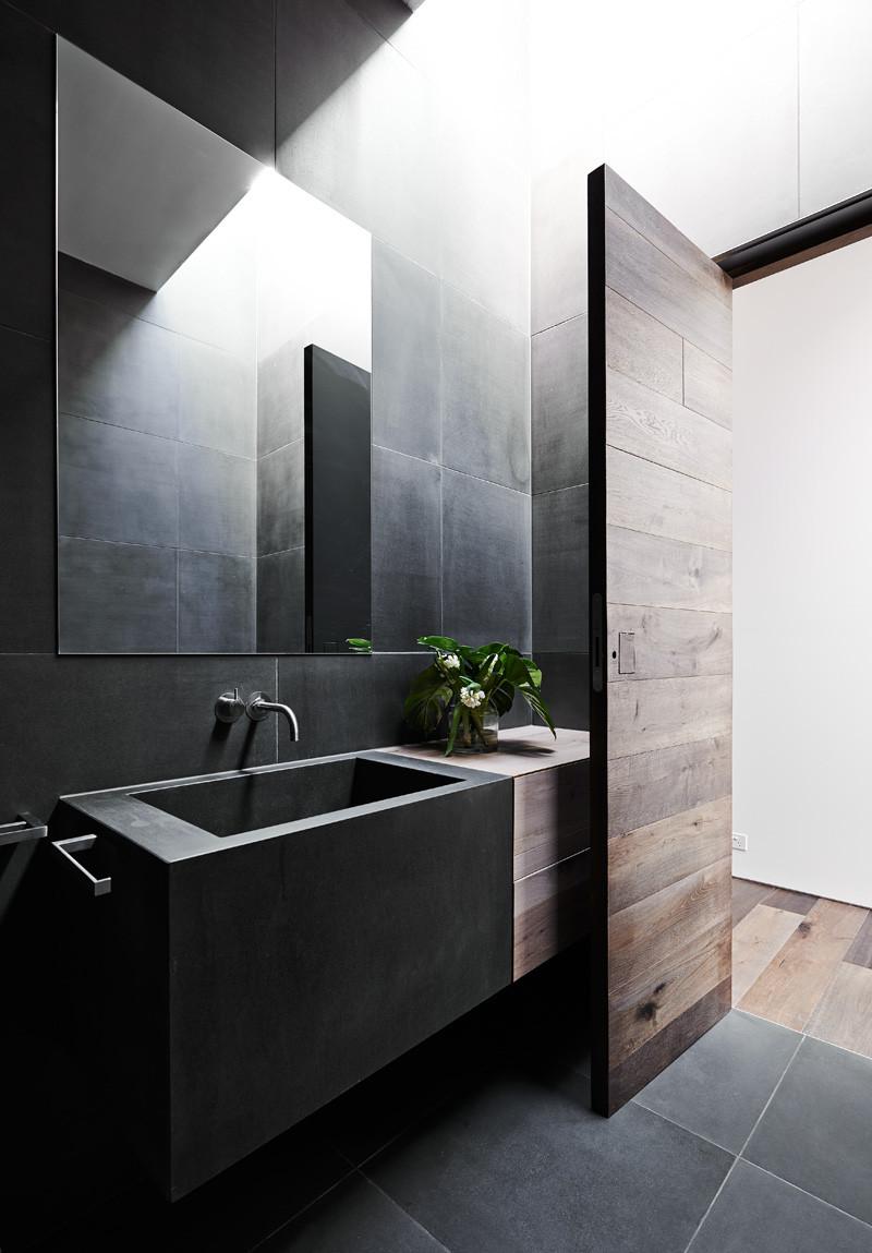 bathroom design trends of 20198 black concrete sink with natural wood accent door