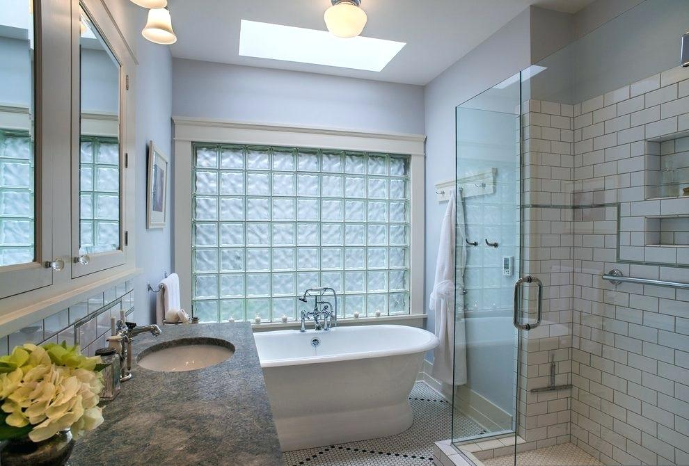 glass block tiles next to bathtub with natural light
