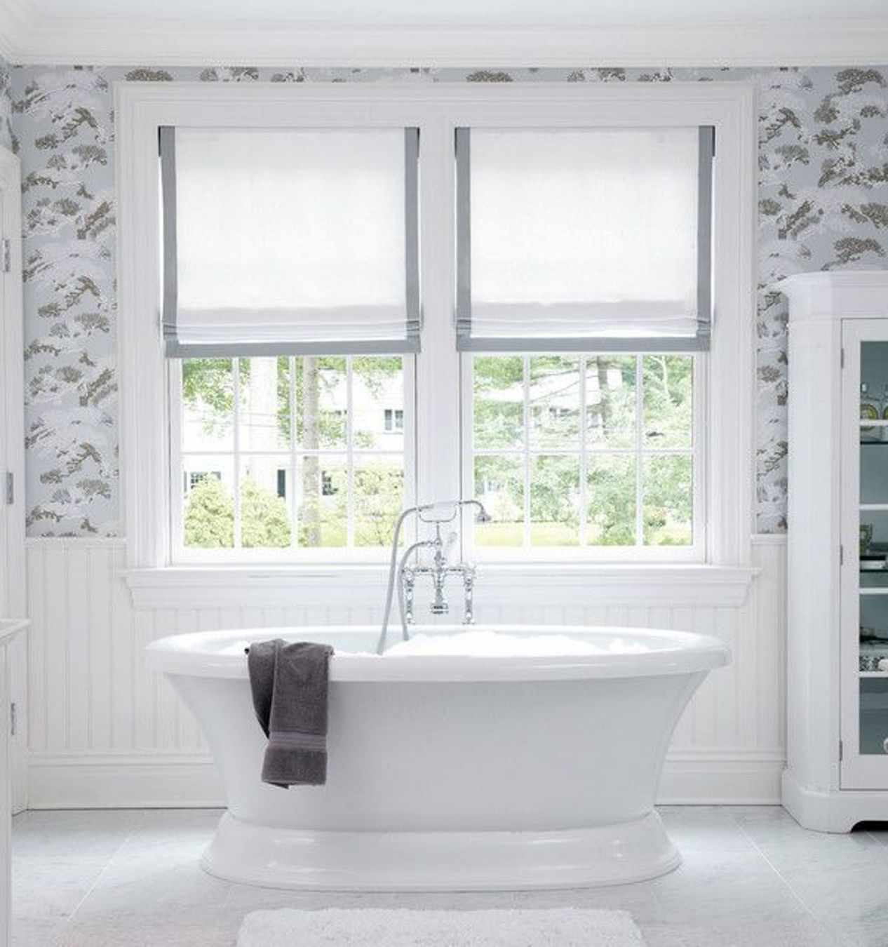 gray trimmed white shades in bathroom stand alone tub
