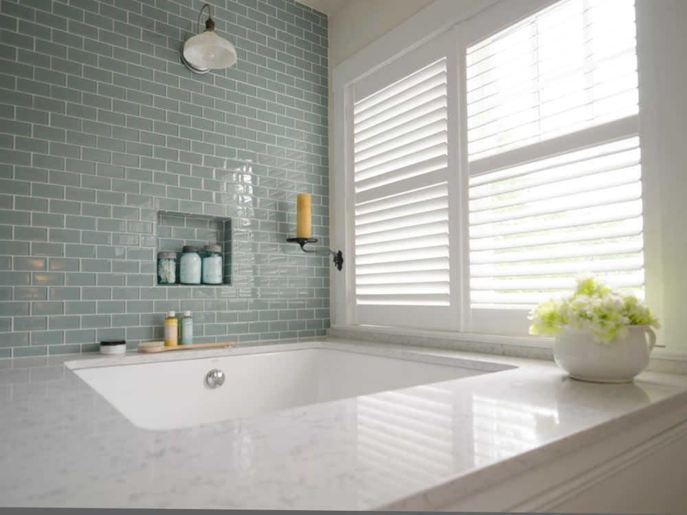 custom plantation style shutters next to bathtub natural light