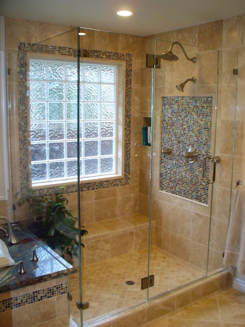 Mediterranean style bathroom with glass block privacy window