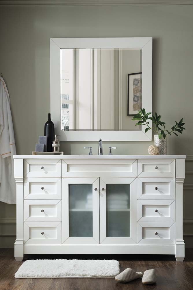 The Weston cottage-style bath vanity with white furniture finish, glass doors, and cultured stone countertop.